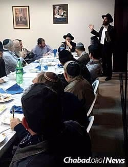Rabbi Yecheskel Posner shares a Torah thought at Chabad in Lima, Peru.