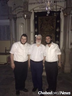 Tubul, right, and Rabbi Mendel Wolowik with the president of the Jewish community of Ioannina in the Romaniote synagogue, said to be more than 1,000-year-old