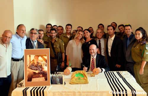 A Torah in memory of Max Steinberg, an American lone soldier killed last summer during Israel's war with Hamas in Gaza, was dedicated on July 12 in Jerusalem in the presence of family, friends and members of his company from the Golani 13 brigade. (Photo: Lone Soldier Center)