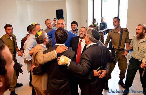 Dancing in celebration of the Torah, the source of inspiration for the Jewish people. (Photo: Lone Soldier Center)