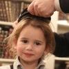 La première coupe de cheveux