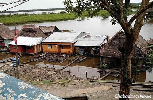 The Amazon River bank on the city of Iquitos, a great part of which is in the water