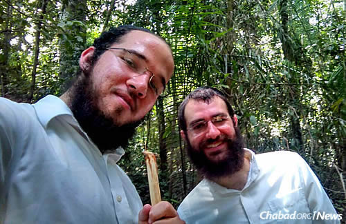 """Chabad rabbinical students Nosson Huebner, left, and Yecheskel Posner spent time in cities and towns in Peru this summer as part of the Merkos Shlichus """"Roving Rabbis"""" program."""