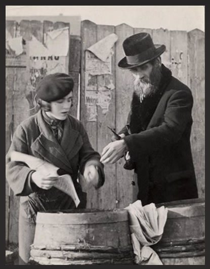 A man purchases herring for Shabbat in Mukacevo. (photo: Roman Vishniac)