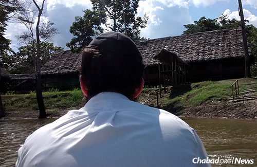 Huebner as seen from a boat on the Amazon, facing a lodge where the two students met many Jews and helped them put on tefillin.
