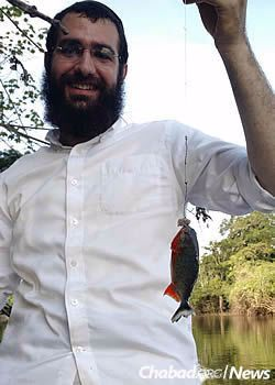 Posner catches a piranha straight out of the Amazon River.