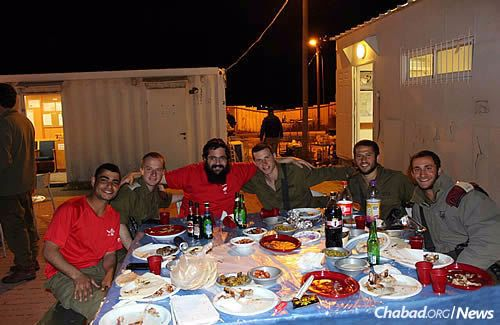 An evening food break for soldiers in Hebron, sometimes with dishes that remind them of home.