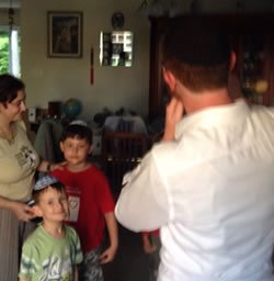 Blowing the shofar for Rima and her children