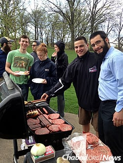 Rabbi Rothstein with students at a cookout. Kosher dining options have increased at the university as a direct result of the involvement of Humphrey and other staff members.
