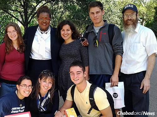 """Humphrey with Rabbi Shmuel Weinstein and students at the school as they hold a """"Mitzvah Marathon."""""""