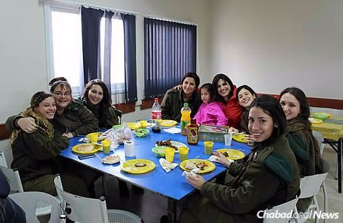 Batsheva Cohen runs a yearly program for local soldiers focusing on the three unique mitzvot of women, with challah-baking, making Shabbat candlesticks and touring the women's mikvah.