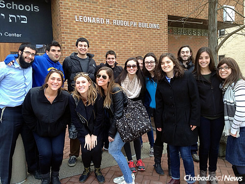 Rabbi Shmuel Rothstein, left, and Chasi Rothstein, right, work with Jewish undergraduates at Pitt. Another couple, Chabad-Lubavitch emissaries Rabbi Shua and Shoshana Hoexter, run graduate-student programs.