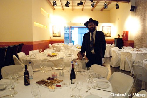 """The increased need will be all but invisible at Chabad's communal holiday meals, where those who have paid for their meals sit side by side with those not able to. """"Every Jew deserves a seat at the Rosh Hashanah table,"""" the rabbi says, """"and the Greek Jewish community is doing an exemplary job at making sure that no one is left out."""""""