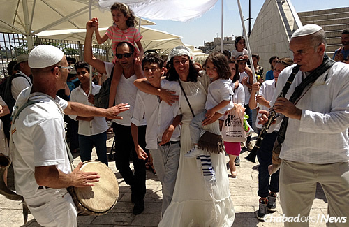 The event concluded with the family being accompanied by musicians to the Kotel, the Western Wall.