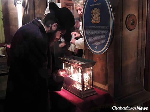 Lighting a menorah inside the Mansion House as well.