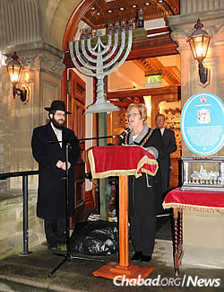 The rabbi with the Lord Mayor of Cardiff Councillor Margaret Jones, addressing those gathered last Chanukah for the city's first public menorah-lighting.