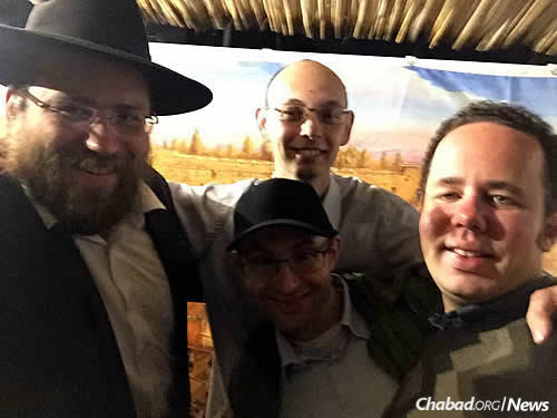 Feldman shares a moment in the sukkah with Shmuel Rozentsvet, Shmuel Sontag and David Perkis.
