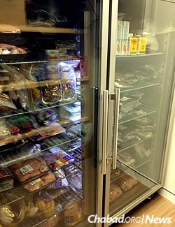 A freezer stocked with a full range of kosher items. Prepared meals are also available.