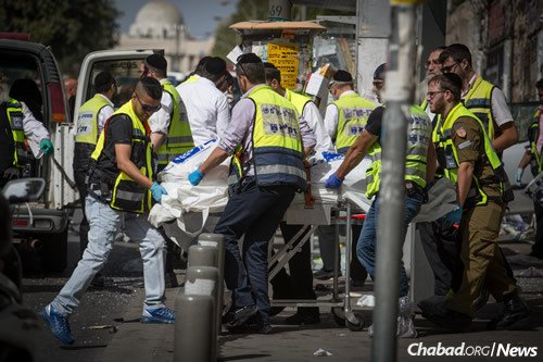 Rescue workers on Malchei Yisrael Street in Jerusalem after a terrorist rammed his car into pedestrians, and then got out and stabbed others, killing one man and injuring at least five people. (Photo: Hadas Parush/FLASH90)