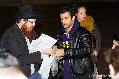 "Charity was also collected by the students that night. Rabbi Boyarsky, left, said he ""was amazed at how well they spoke—really amazed. They spoke from their hearts."" (Photo: Erik Plumadore)"