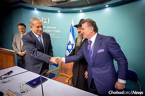 The premier and Jewish philanthropist Mikhail Mirilashvili, who is based in Russia and Israel. Philanthropist Lev Leviev, president of the Federation of Jewish Communities of Russia, is at the left. (Photo: Ezekiel Itkin)
