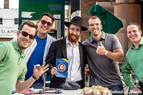 Rabbi Dovid Kotlarsky, co-director of Chabad of East Lakeview on Chicago's North Side, has set up a tefillin booth outside of Chicago's Wrigley Field that encourages baseball fans to do a mitzvah.