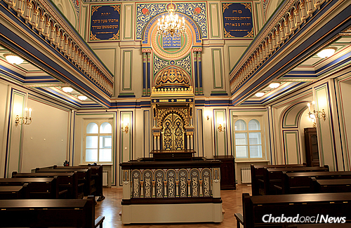 "The ""Small Synagogue"" of St. Petersburg's gold-covered bimah, uniquely patterned ceiling and wooden floors exemplify the architectural glory of the synagogue."