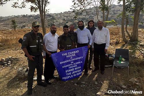 Chein, Kutner and Miller, along with Rabbi Ahronchik Prus, right, of the Chabad Youth Organization, visit soldiers guarding the Armon Hanatziv neighborhood of Jerusalem, where several terrorist attacks have taken place over the course of the month.