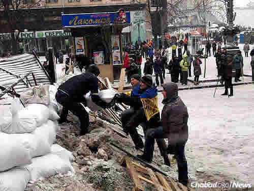 Pro-European demonstrators build a barrier in Kiev during the Maidan Revolution. Some 100 protesters were killed in skirmishes with government troops trying to quell the protests, which ultimately led to President Viktor Yanukovych fleeing Ukraine in February of 2014.