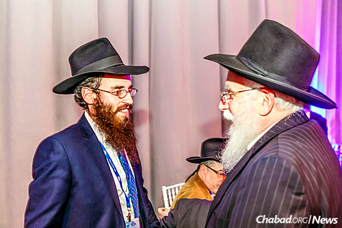 Rabbi Chaim Goldstein, left, co-director of Chabad Serving Drexel University, with his father, Rabbi Aharon Goldstein, director of the Chabad House of Ann Arbor, Mich. (Photo: Eliyahu Parypa/ Chabad.org)