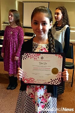 Eden Lev displays her Bat Mitzvah Clubs International certificate. This year, she will participate in the Beyond Bat Mitzvah Club.