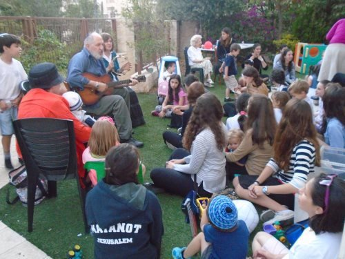 Even as threats of terror hovered in the background, children with special needs and teen volunteers gathered for music and camaraderie.