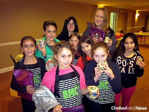 A group of girls from a prior club year. Hannah Newman, second from right, now 15, enjoyed the experience; her younger twin sisters have started taking part in it. To her left is Shterna Kaminker, coordinator of the club and co-director of the Israeli Chabad Center in Voorhees, N.J.