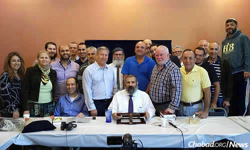 Rabbi Yehoshua B. Gordon's California study group two years ago, when the class completed the three-year track of Mishneh Torah. His teaching continues to draw tens of thousands of online students to classes on Jewish.tv.