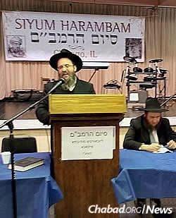 Rabbi Mordechai Farkash, co-director of the East Side Torah Center-Chabad in Bellevue, Wash., speaks at a prior Siyum HaRambam celebration.