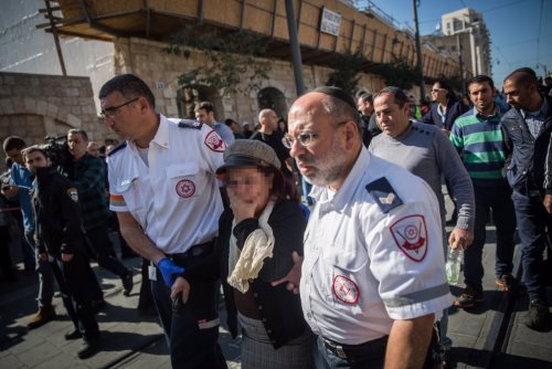 Emergency responders accompany a woman in shock following a stabbing attack on Jaffa Road. (Hadas Parush/Flash90)