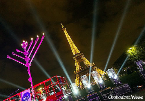 The lighting of a giant menorah will take place at the base of the Eiffel Tower on Sunday—the first night of Chanukah—despite the fact that Paris is still grappling with the aftermath of recent terror attacks. Chabad will also sponsor outdoor public lightings around the city and its suburbs. (Photo: Chlouchim.com)