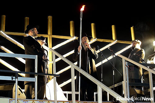 The lighting of the first candle on the Chanukah menorah in Revolution Square in Moscow.