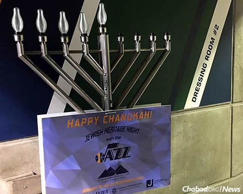 """Despite the minor setback, Chabad's planned Chanukah menorah-lighting celebrations went on as scheduled. Here, a different menorah for use as part of """"Jewish Heritage Night"""" at the Utah Jazz basketball game on Wednesday."""