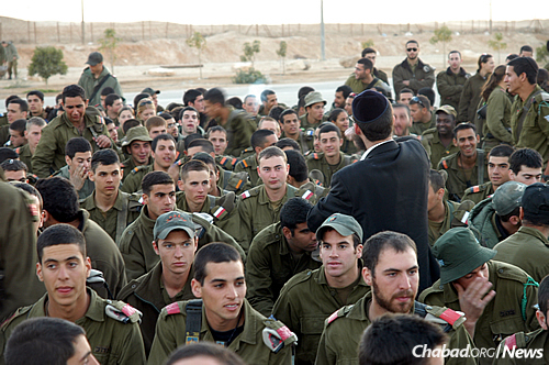 """We have 15,000 soldiers at different bases in the Arava desert region, and we visit all of them,"" says Rabbi Mendi Klein, director of Chabad of Eilat. His wife, Chana Klein, adds that they also hold sizable Chanukah menorah-lightings and events for local residents and the throngs of tourists there. (Photo: Chabad of Eilat)"