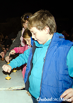 Kids and adults alike took to the spinning tops. (Photo: Meir Alfasi)