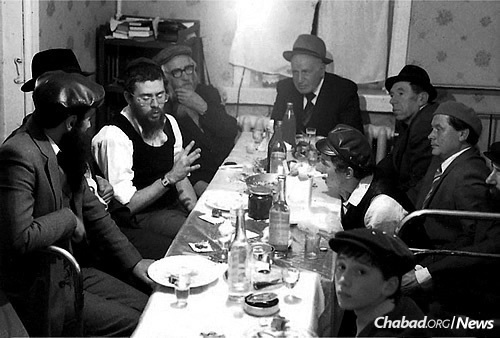 At a secret farbrengen in Moscow circa 1983: Reb Getche Vilensky is fourth from the left, clutching his beard.