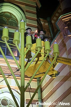 Rabbi Mendel Pewzner, chief rabbi of St. Petersburg since 1992, lights the giant menorah standing outside the city's Grand Choral Synagogue, barely a ten minute drive from the fortress where Rabbi Schneur Zalman of Liadi was imprisoned in 1798.