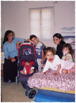 Safed's Benisti family has been allotted one room in Kfar Chabad's makeshift dormitory-style refugee camp. Photo: Rachel Sprintzer