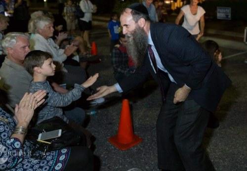 Judah enjoys a light moment with Chabad Rabbi Zvi Konikov.