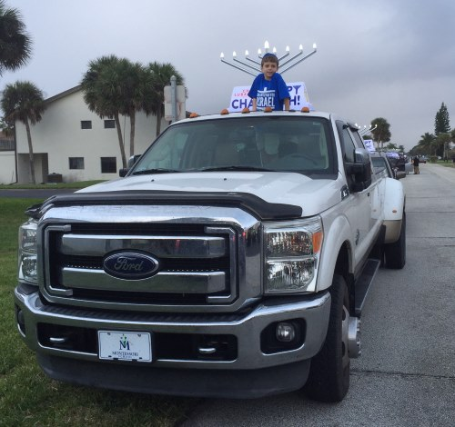 Our truck took its place in the car-menorah parade in Florida.