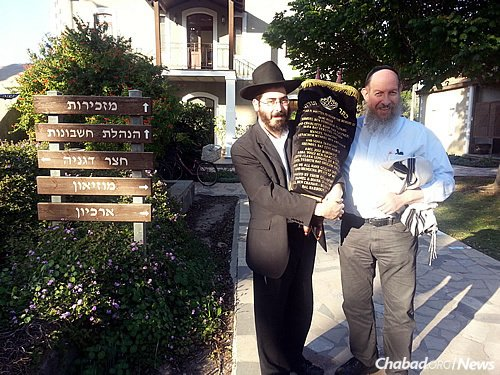 """At Kibbutz Degania, Rabbi Yosef Yitzchak (""""Fitchi"""") Blau, left, director of Chabad at Kibbutz Kinneret who also serves Degania, stands with Bentzion Chanowitz, administrator of the Beis Yisroel Torah Gemach in Brooklyn, N.Y., a project of Merkos Suite 302."""