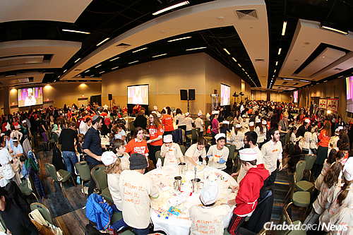 """Representatives from the Guinness World Records were invited to observe and confirm that the event did indeed prove to be """"the world's largest baking lesson."""" (Benams Photo)"""