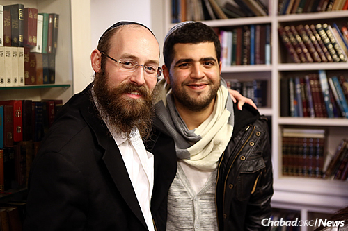 Rabbi Shneur Simcha Landa, who co-directs Chabad at Netanya Academic College in Israel, with a student there