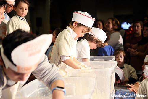 Kneading the dough; both boys and girls were involved. (Benams Photo)
